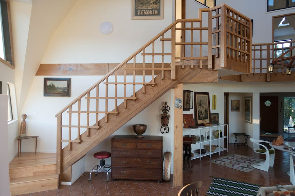 Staircase to balcony and the three upstairs bedrooms.