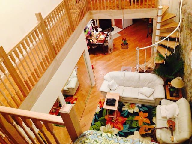 Walking from the Loft to the Magnificent Bedroom is a pleasant adventure via the safe walkway from which you can peer down into the cavernous living room that we call The Cave. Check out the natural two-story granite cliff wall on the right!