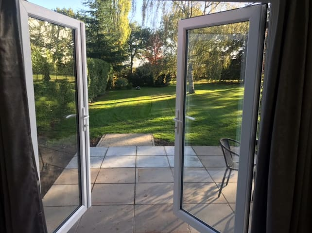 French doors opening out to the patio and garden
