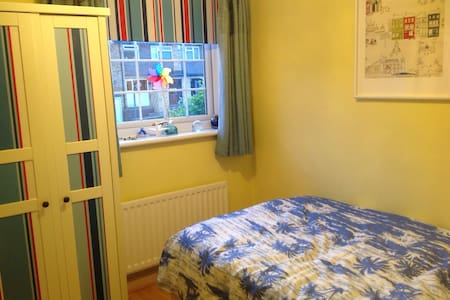 Our sunny seaside bedroom small double bed