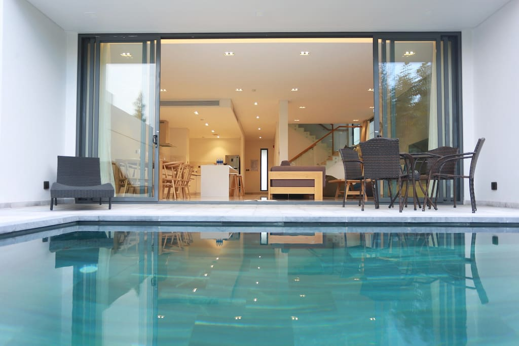 Swimming pool with sun chair and coffee table