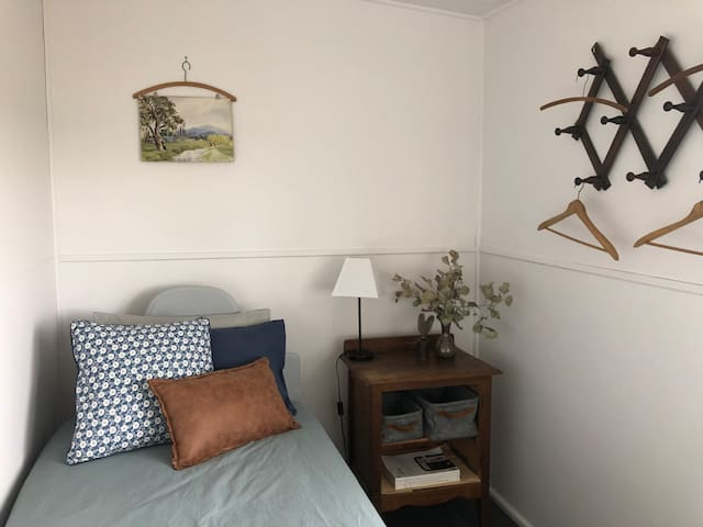 The third bedroom, a cosy space with a lovely rural view.