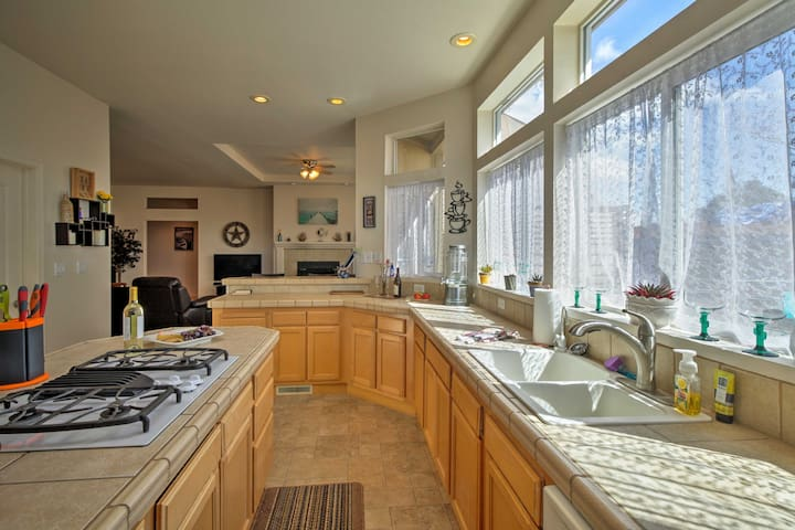 The high ceilings give the kitchen a spacious and inviting feel.
