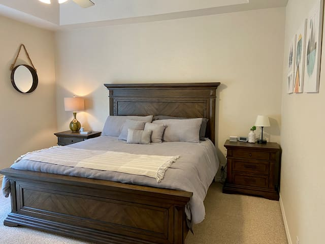 Bedroom #1 with King bed and large private bathroom with jetted tub and walk in shower.
