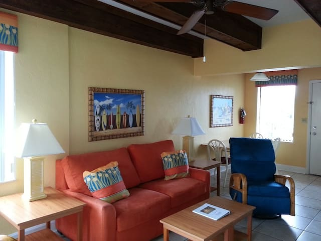 Bright common room, dining space for 6, sofa sleeper, two recliners and TV.