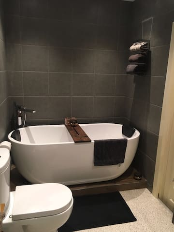 Newly refurbished bathroom with freestanding bath and separate shower