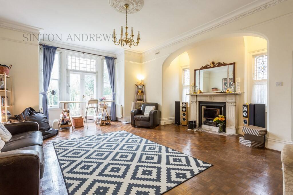 Classic high ceilings in a large living room area with stunning parquet flooring overlooking the beautiful garden