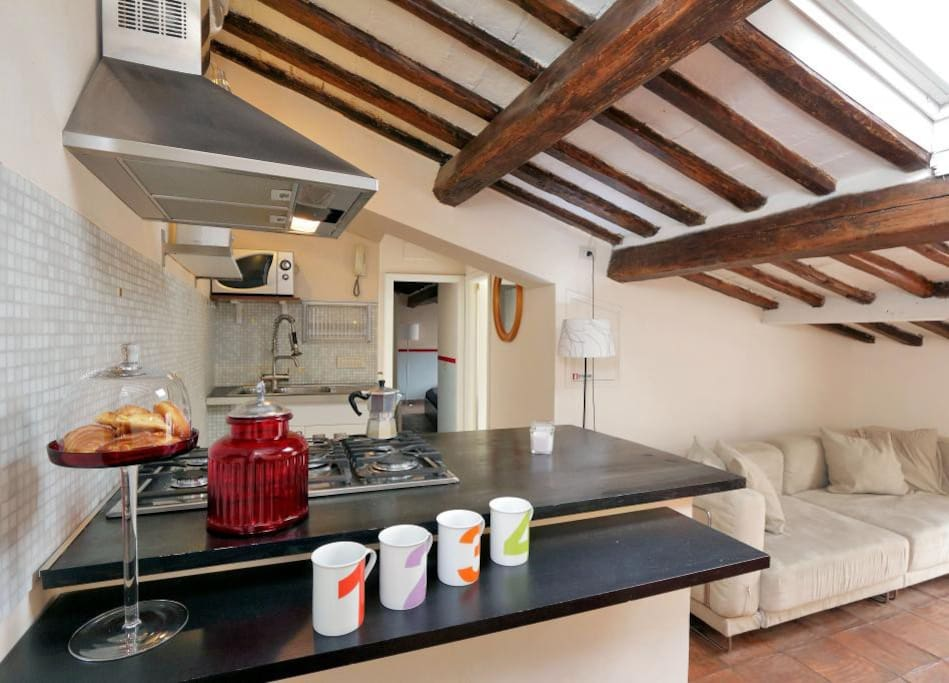 The living area combines with an open-plan kitchen and contains a comfortable double sofa-bed, a smart coffee table, a small table for two and a fully equipped kitchen with everything required to cook a perfect dish, such as a hob and a microwave.