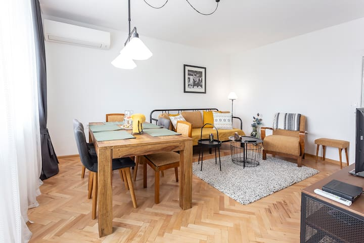 Living room with open plan kitchen.