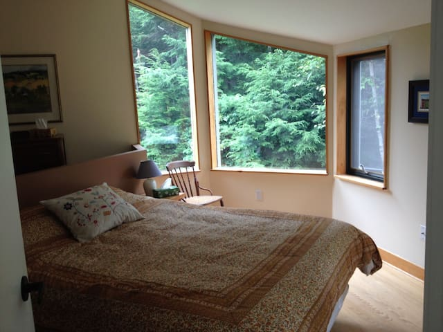 Master bedroom upstairs with high ceilings, open concept to living area and fantastic sunrises.