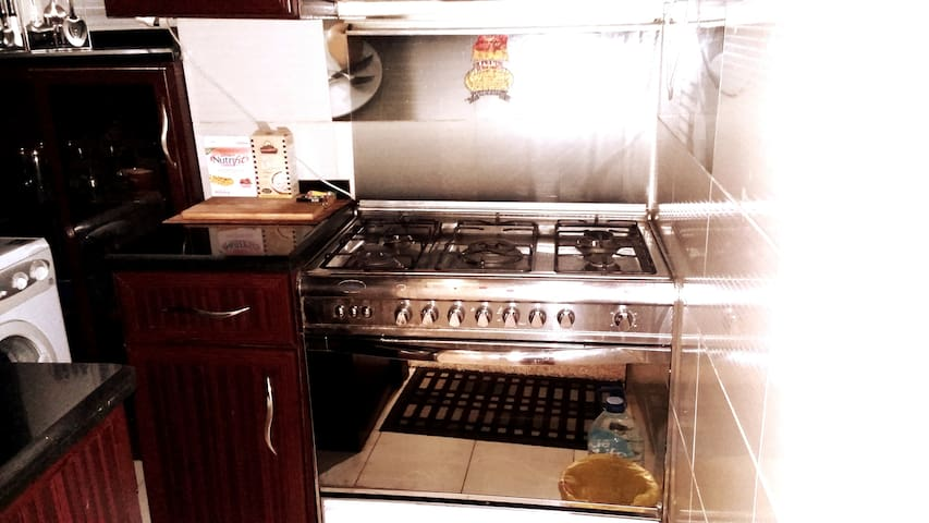 * Large silver cooker with five burners  And an oven