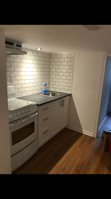 Full kitchen with fridge and stove
