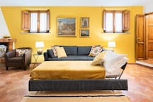 Sofa with trundle converts to two single beds.