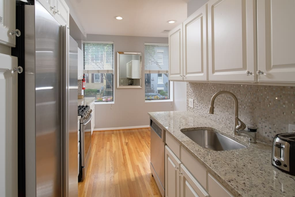 You won't want to leave this attractive kitchen, which boasts only the most efficient stainless steel appliances.