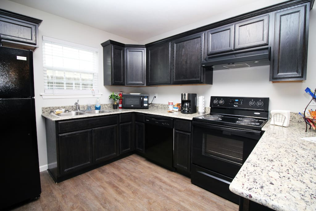 Great modern kitchen with granite countertops and soft-close cabinets.