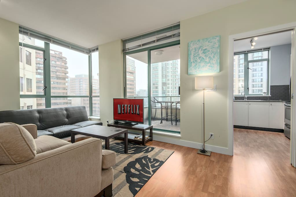 Bright living room with oversized balcony. Free Netflix subscription.