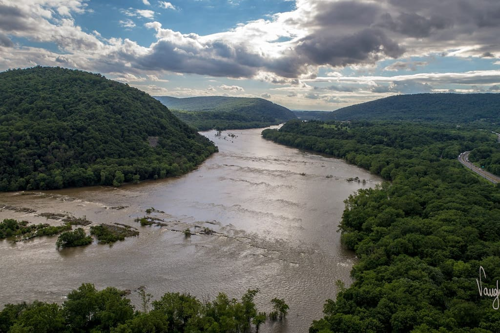 View up the Potomac River. The mountain gap is where the Shenandoah and Potomac Rivers converge at Harpers Ferry, WV. Shot with a drone across the street from our house.