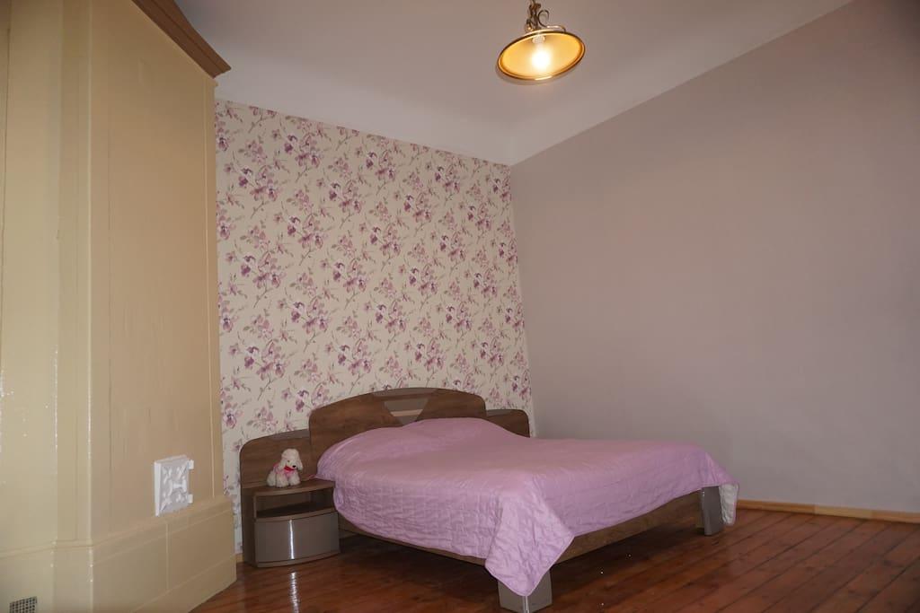 Queen bedroom with large wardrobe and renovated wooden floor