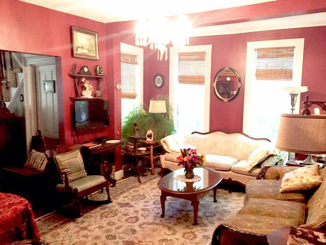 "Andrew January 2019 ""the furnishings [were] amazing to look at, especially for a lover of antiques."" Living area. ""The house exceeded expectations. Great back porch...Lots of unique furniture, charm and warmth""Terry February 2016"