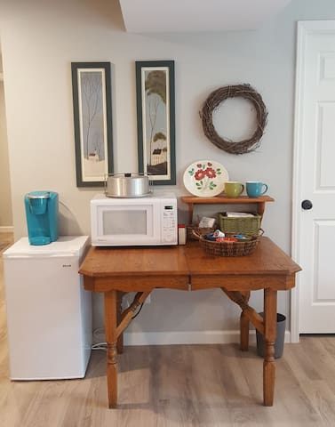 Guest convenience area includes Wi-Fi, mini fridge, microwave and Keurig.