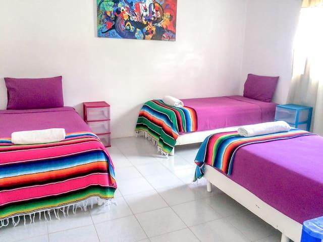 Bedroom 2 - 3 single beds (Upstairs)