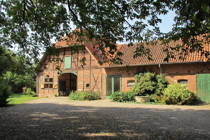 Historic half-timbered farmhouse in the Lüneburg Heath with wood stove