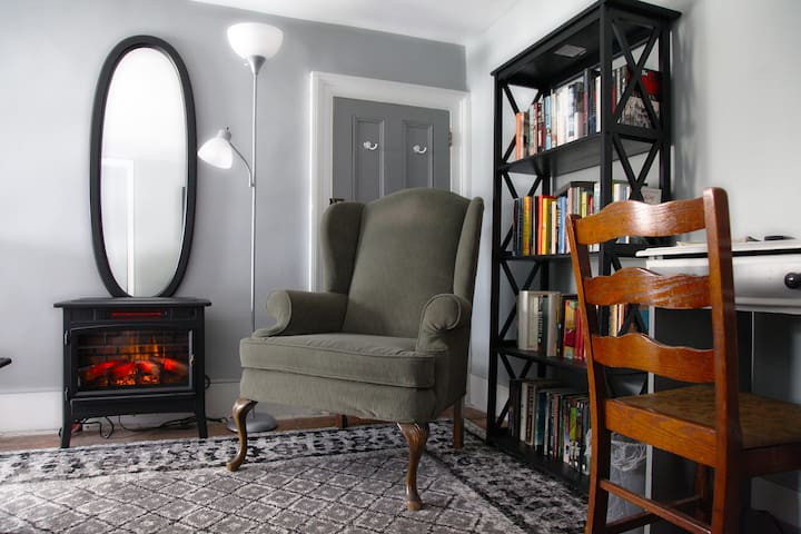 An electric wood stove allows you to heat your room accordingly.