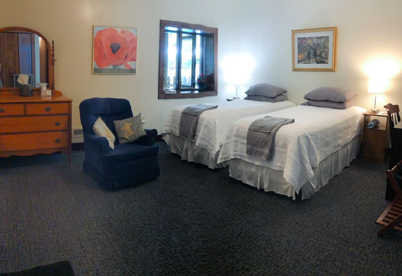 Room can be made up with two twin beds or one king size bed. Windows open up to the pool and back yard.