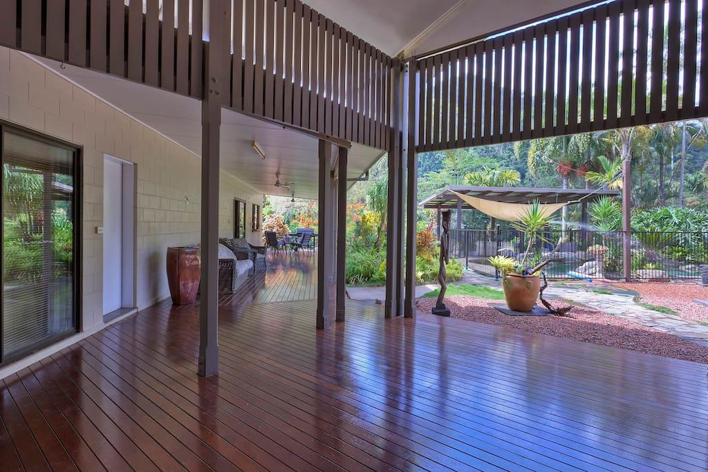 massive verandah surrounded by amazing tropical gardens