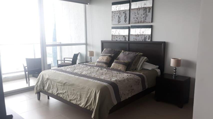 Bedroom with queen size bed and ocean view