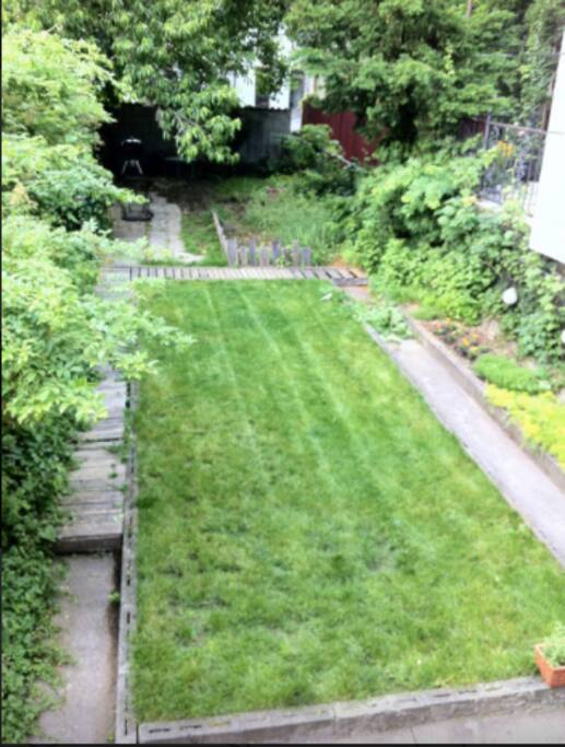 Outdoor access to Large Backyard space with fire pit and bbq