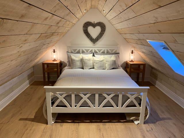 Mezzanine bedroom. Limited head room !