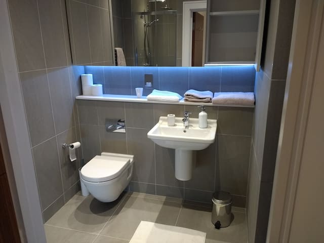Private bathroom with underfloor heating