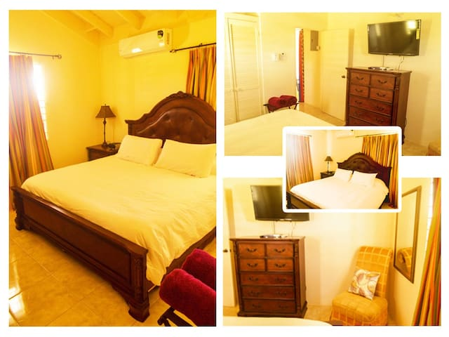 King Bedroom - closet ,  chess of draws, bedside table,  ceiling fan, cable TV, clock radio, full size mirror air conditioning, lounge chair