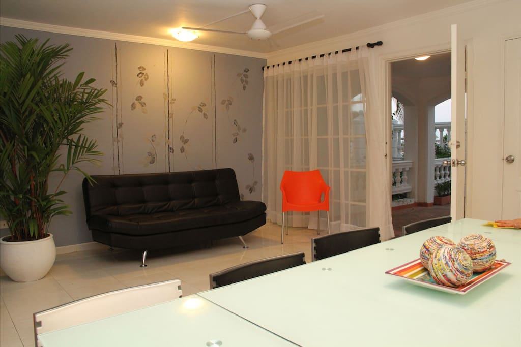 Living room with sofa bed, air conditioner, 40 inch LCD TV, air conditioner and dining table for 10.