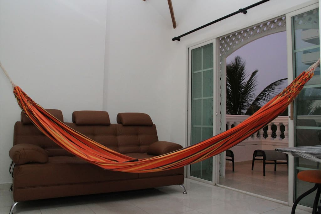Studio with sofa bed and hammock.