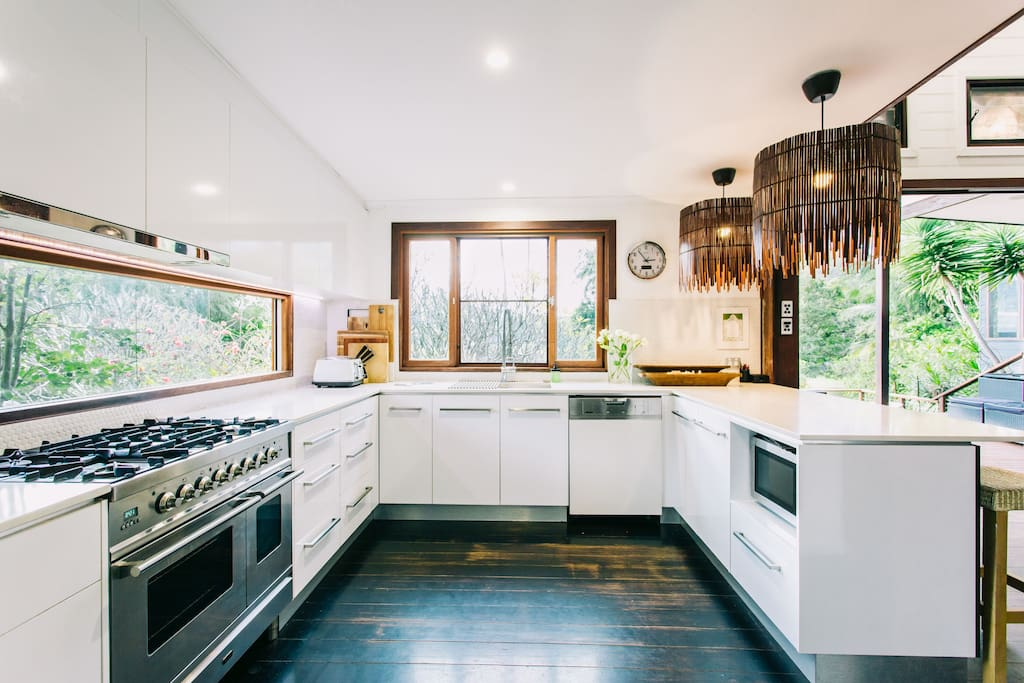 Cook up a feast in the vast open planned Kitchen, equipped with all the mod-cons (including a commercial coffee machine (BYO coffee beans) with spectacular views of the garden.