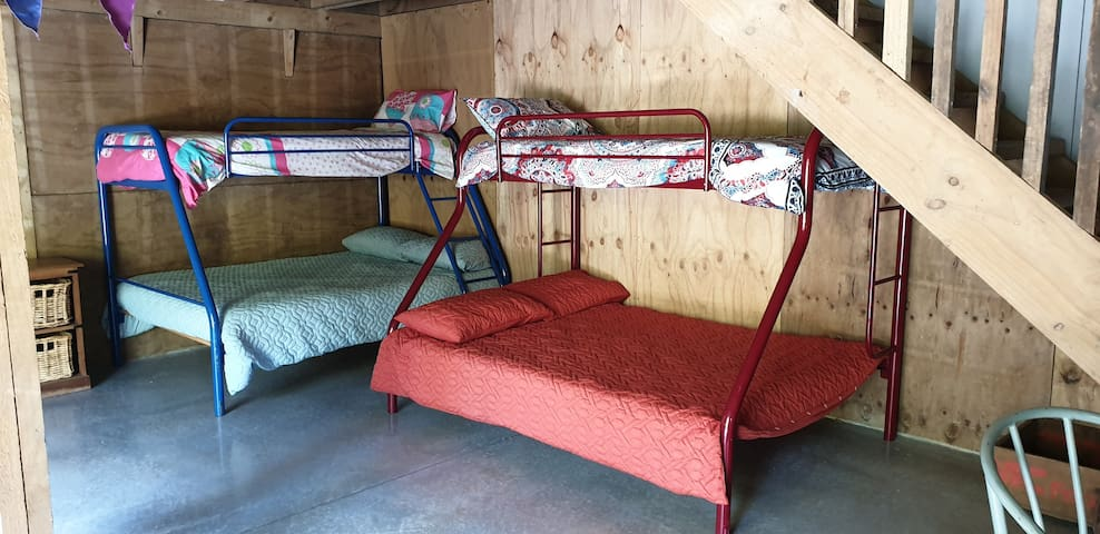 2 bunks on the ground floor both with a double bed on the bottom and single on top.