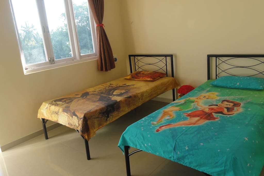 Children's Bedroom with 2 Single Beds and Attached Balcony