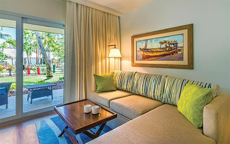 A ROMANTIC GETAWAY or RELAXINT VACATION at our BEACH FRONT RESORT in a Stylish Studio Suite!