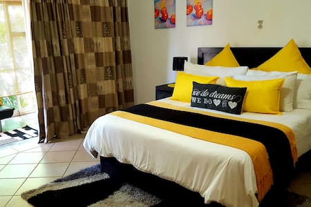 One of the rooms in the Standard Sharing rooms. Bright happy colours.
