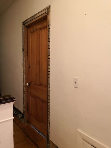 The door to The Lodge, private room.  The molding will eventually be replaced.
