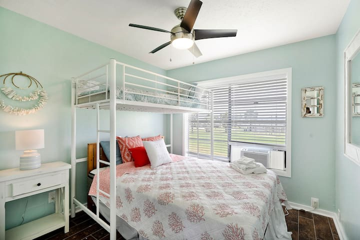 This bunk room has a queen-size bottom bunk and a twin-size top bunk.