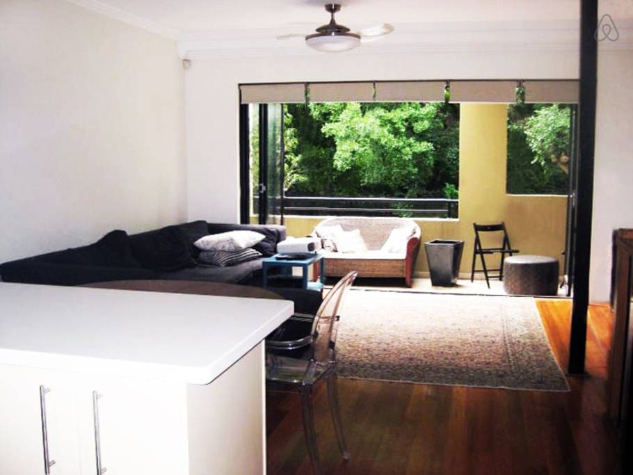 Our lounge is fresh and bright, with hardwood floors and glass doors opening up to the balcony.