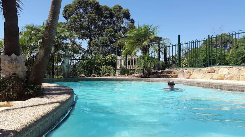 Having a dip. Solar heated pool, sun exposure all day long.
