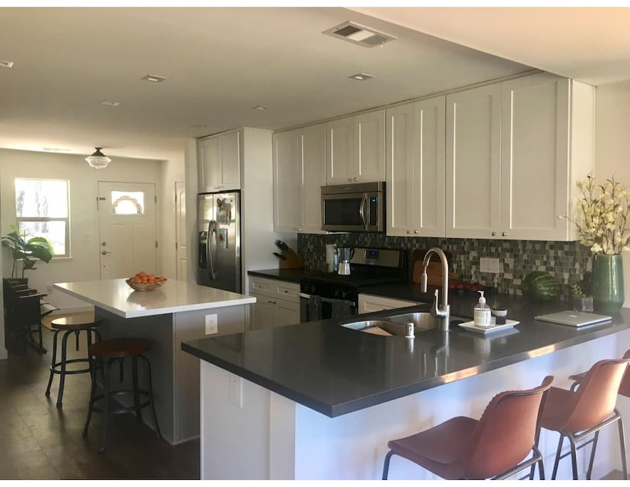 Kitchen with granite countertops and lots of bar seating