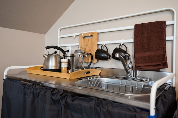 Kitchenette: Electric tea kettle, French press, mini fridge, microwave.