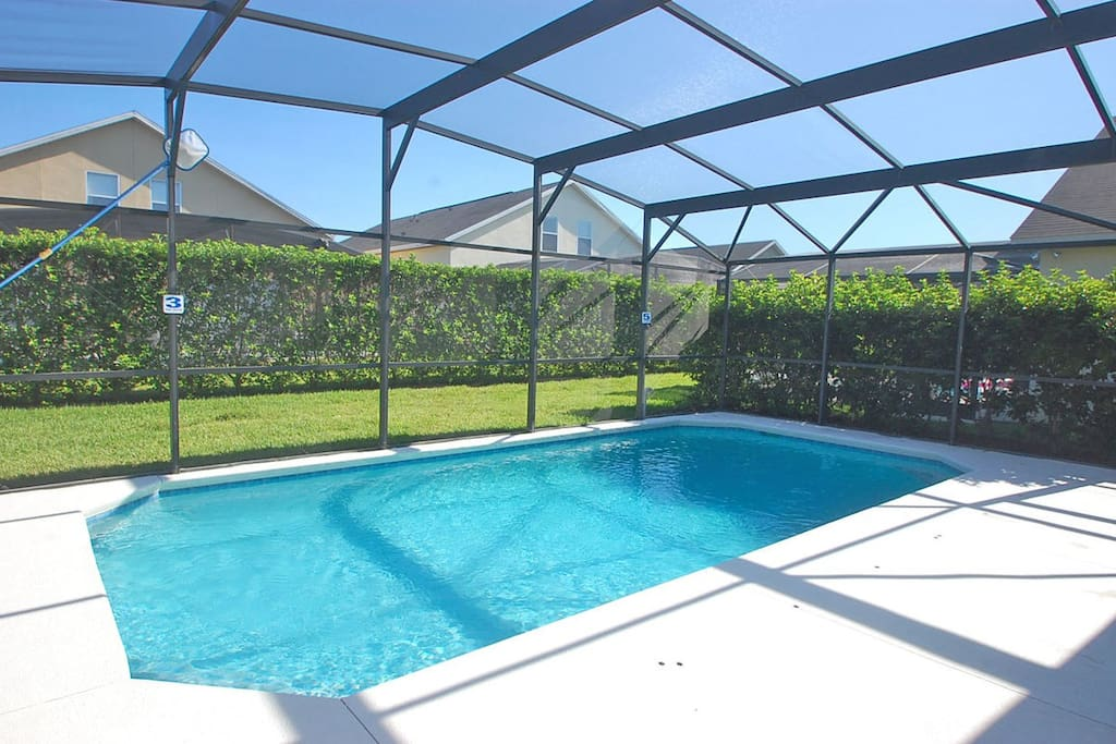 Alternative view of pool with privacy hedges
