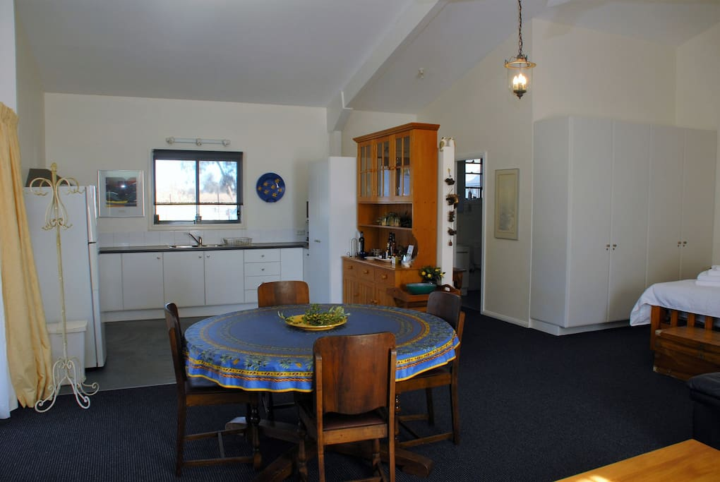 Fully equipped kitchen including coffee machine and dining