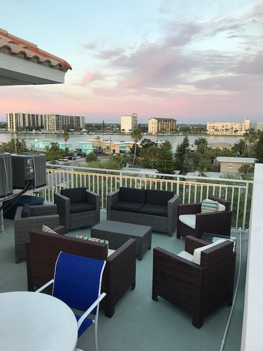 Chilling on the terrace with breathtaking panoramic views of the gulf & bay!